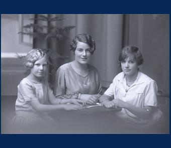 Photograph of a family from the Bond Studio