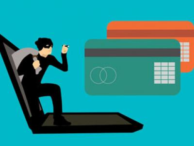 Image of a hacker and credit cards